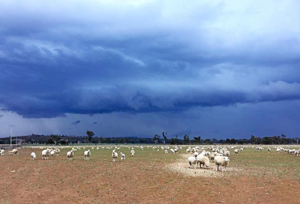 Storm clouds form over a farm.