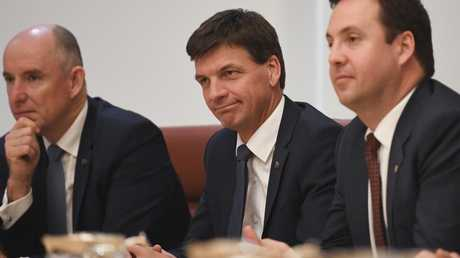 "Energy Minister Angus Taylor (centre) has acknowledged ""prices are no longer sustainable""."