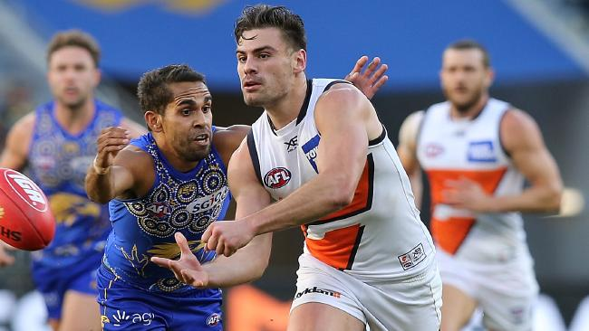 Stephen Coniglio gets a handball away.