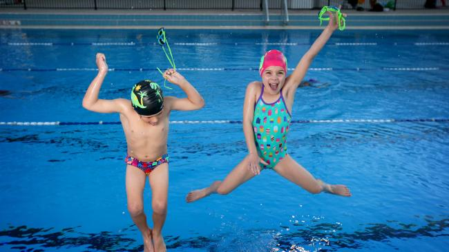 Noah Graham, 6, and Sophia Mitchell, 7, jump for joy at the news. Picture: Steve Pohlner/AAP