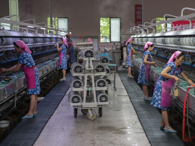 Women work in the Kim Jong Suk silk factory. Picture: Carl Court/Getty Images
