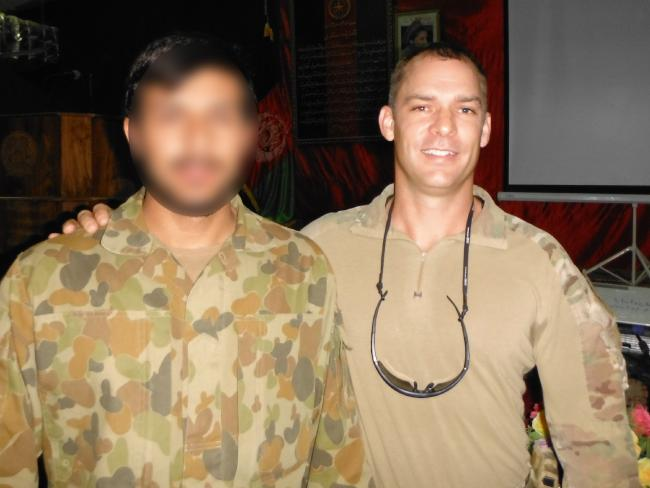 Captain Jason Scanes and his interrupter in Afghanistan, whose life is in danger over his assistance to coalition forces.
