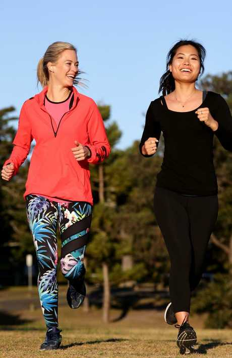 "Teachers Gita Smith and Julie Zhang, go for a run in Centennial Park. Gita said she avoided ""confusing"" fads. Picture: Jonathan Ng"