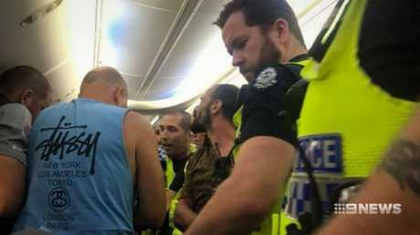 Passengers stepped in to help calm the situation. Picture: 9 News