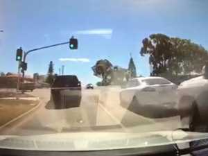 WATCH: Disaster narrowly avoided as car runs red light