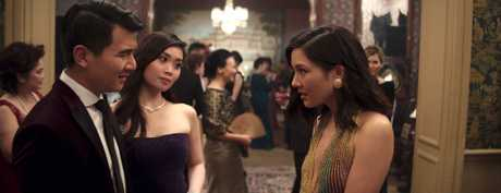 Ronny Chieng, Victoria Loke and Constance Wu in a scene from Crazy Rich Asians.