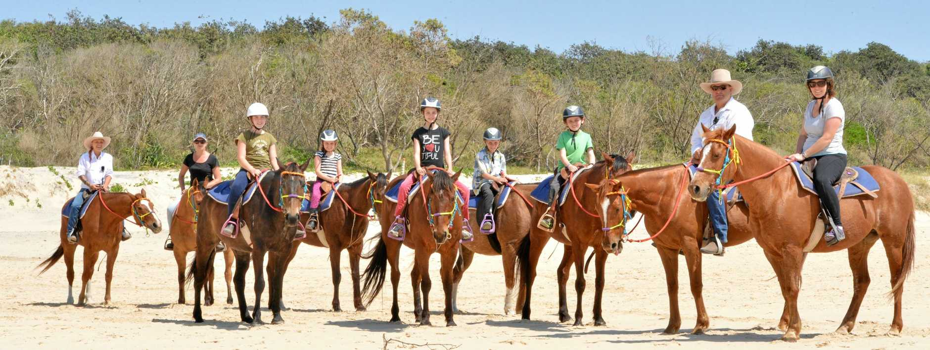 Holiday snaps.  Rainbow Beach Horse Ride for Nicole Handel, Dianna Rodenburg, Alice Brachold, Michaella Stephens, Hannah Buchanan, Nikolai, Andreas Brachold, lead horseman Andrew McCarthy with Georgie Brachold.   Photo Tanya Easterby / The Gympie Times