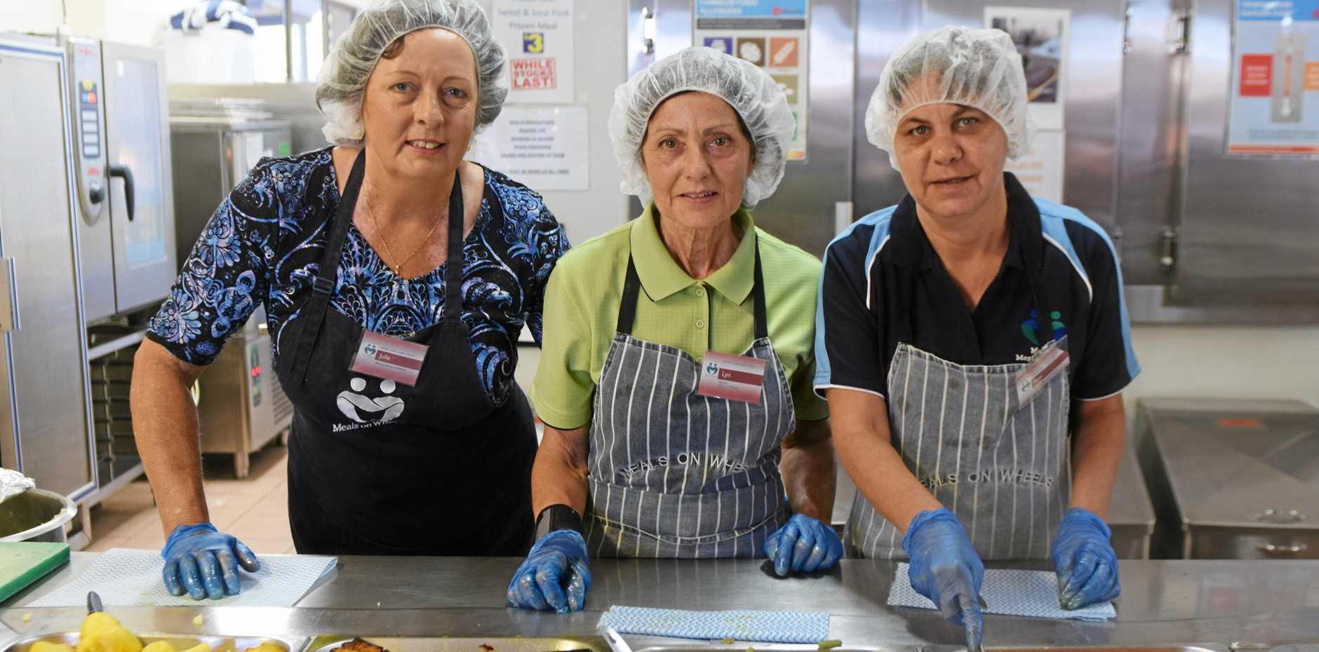 Mackay Meals on Wheels volunteers Julie Williamson, Lyn Macfarlane and Ann Engman, cooking up a storm.