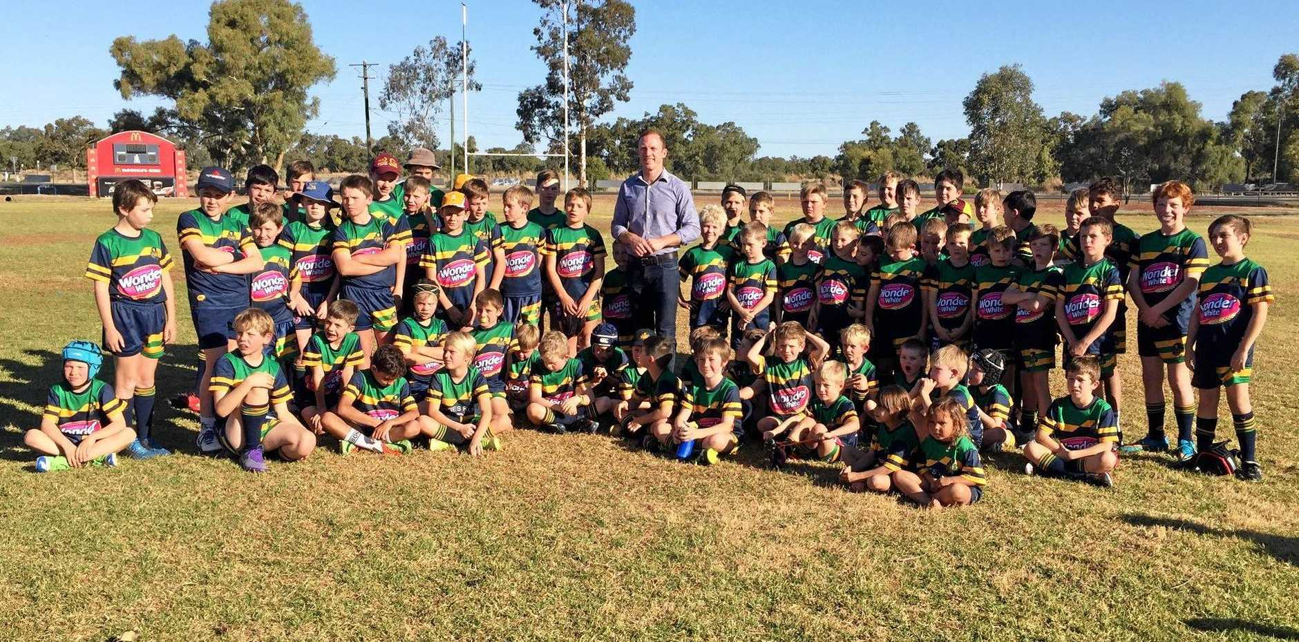 LION'S ROAR: The Carnarvon Cubs, picture here with Darren Lockyer, will feature at the grand final day.