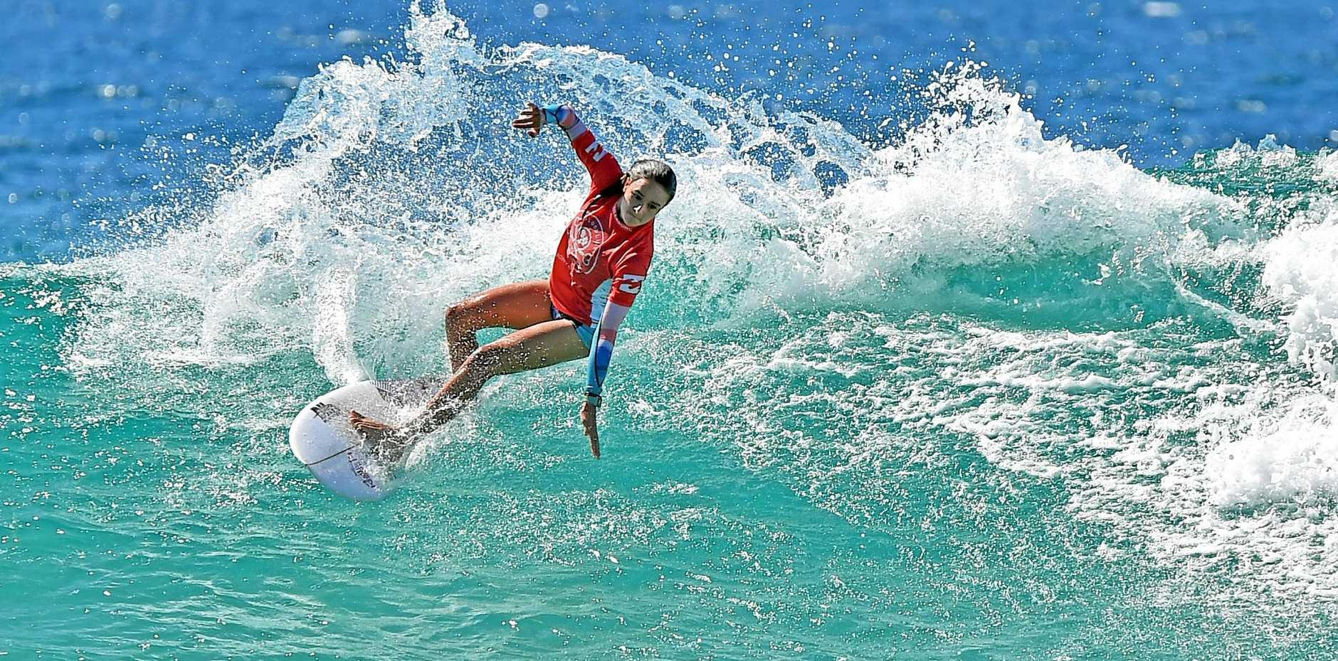 HOLLY Williams drives into a cutback on a perfect wall during the Billabong Parko's Grom Stomp at Currimundi Beach on her way to winning her heat in the Girls 16 years and Under.