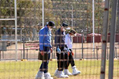 Asbestos Removal Queensland workers and Southern Downs Regional Council staff survey the Collegians Junior Rugby League football field after soil testing confirmed positive traces of asbestos.