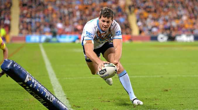 Former Grafton Ghosts flyer Anthony Don scores a try for the Gold Coast Titans during the round 10 NRL upset against the Melbourne Storm at Suncorp Stadium.