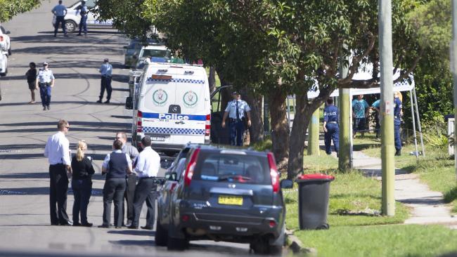 Police at the scene of Davey's murder.