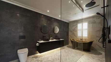 The couple's second bathroom, with a signature gold bath. Source: The Block