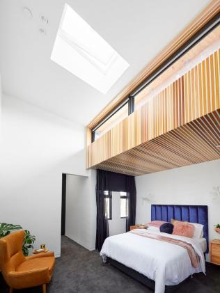 Bianca and Carla's guest bedroom makes the most of its soaring ceilings. Source: The Block
