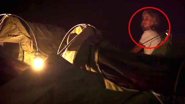 Romy busts into Nick's tent moments before rutting noises are heard.