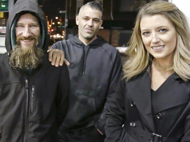 Johnny Bobbitt Jr., left, Kate McClure, right, and McClure's boyfriend Mark D'Amico.  Picture:  AP