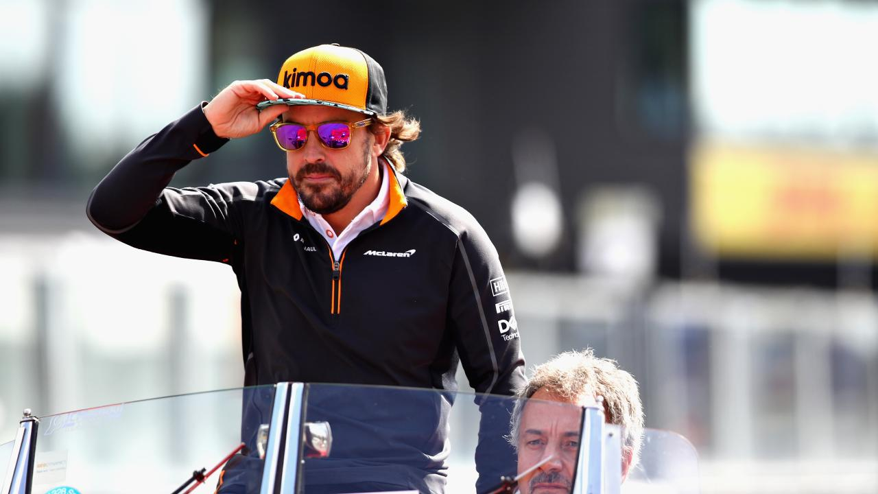 Fernando Alonso waves to the crowd before the Belgium GP. (Photo by Mark Thompson/Getty Images)
