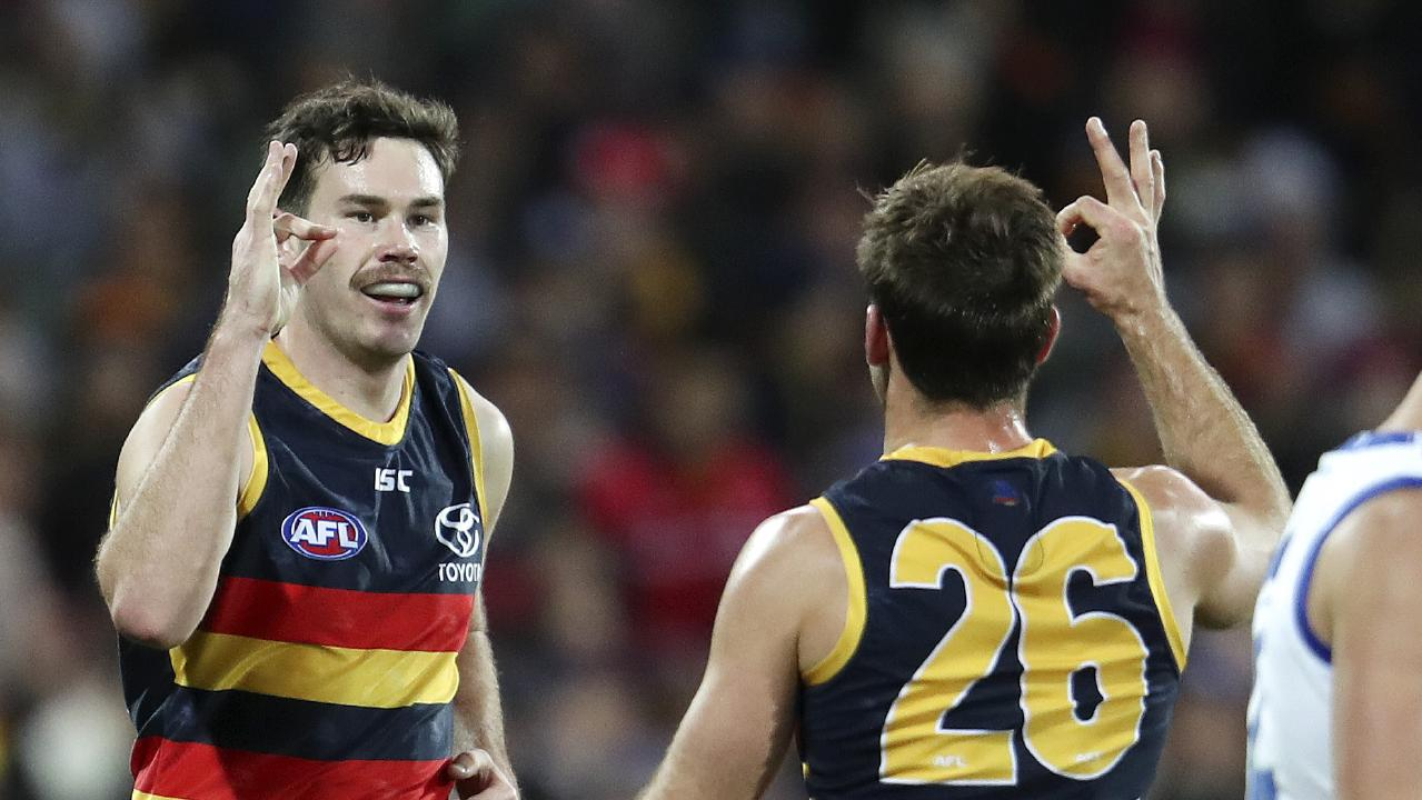 Crow Mitch McGovern, celebrating a goal with teammate Richard Douglas against North Melbourne in round 22, wants out of the club. Picture: Sarah Reed.