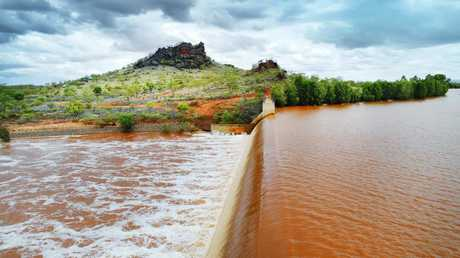 A free-flowing Chinamans Creek Dam at Cloncurry. Picture: Lachie Millard