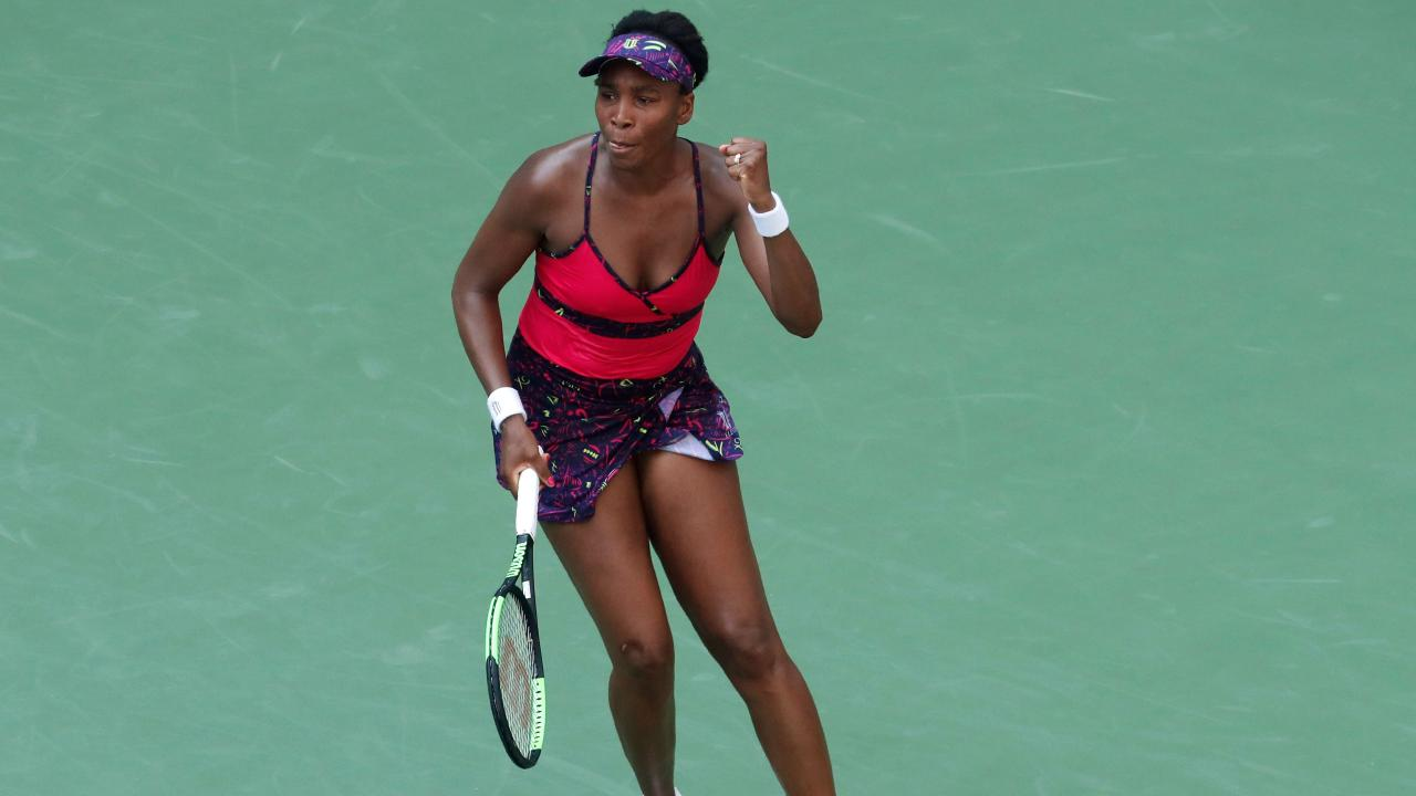 Venus Williams of the US celebrates a point against Camila Giorgi of Italy.