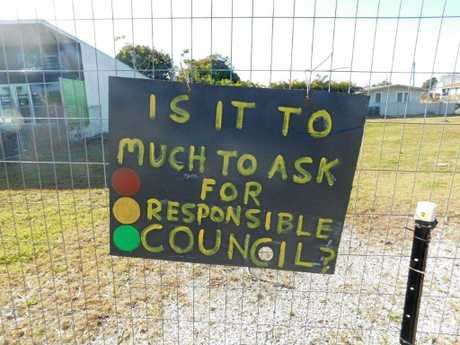 Sings that protest the lights and service station proposed in Yamba.
