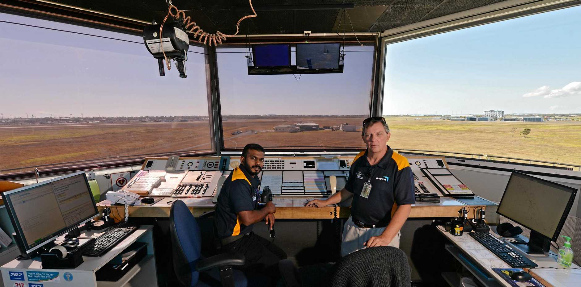 Mackay Airport control tower. Air traffic controllers Prashneel Chand and Allan Maddison
