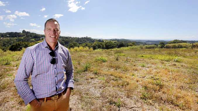 DEVELOPER'S DREAM: Craig Parsons stands on the 50-hectare property, which could be turned into a massive residential estate.