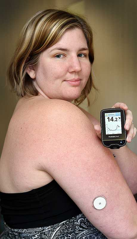 Type 1 diabetes sufferer Rhiannon Kellaway with her new blood testing monitor.