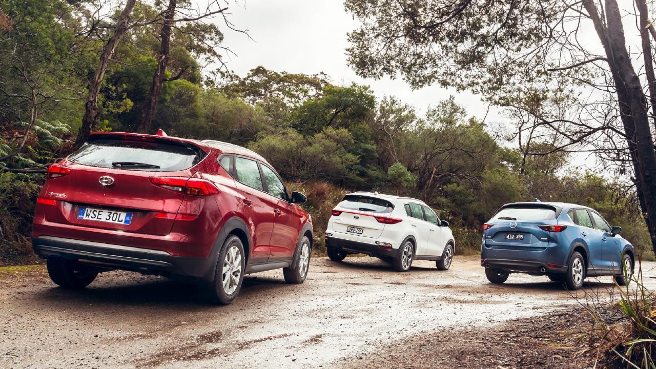 The Hyundai Tucson, Kia Sportage and Mazda CX-5, from left to right. Picture: Thomas Wielecki.