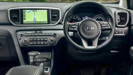 The Kia Sportage has soft-touch materials on the dash but not on the doors. It shares the Hyundai's 8-inch touchscreen and digital speedometer display. Picture: Thomas Wielecki.