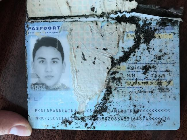 A passport found at the scene. Picture: Supplied to News Corp