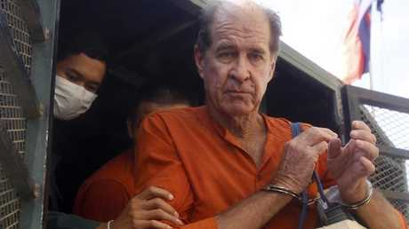 James Ricketson gets off from a prisoner truck upon his arrival at Phnom Penh Municipal Court in Phnom Penh, Cambodia, Wednesday, Aug. 29, 2018. Picture: AP.