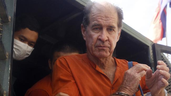 Australian filmmaker James Ricketson gets off from a prisoner truck upon his arrival at Phnom Penh Municipal Court in Phnom Penh, Cambodia. Picture: AP / Heng Sinith.