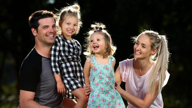Brenton and Kate Trevethan with daughters Sophie, almost 4, and Milly, almost 2. Picture: Adam Head