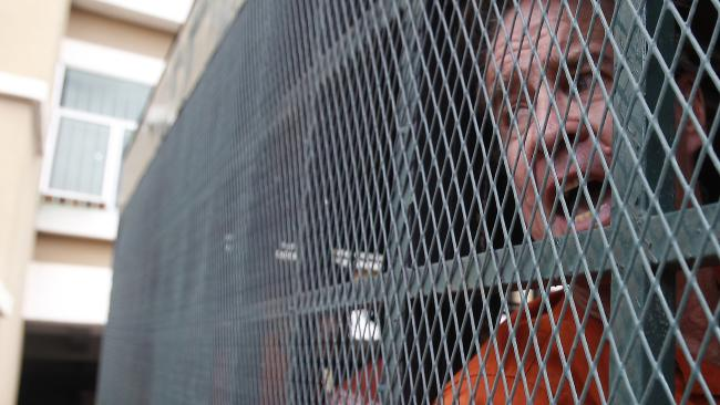 Australian filmmaker James Ricketson in a prison truck as he arrived at the municipal court in Phnom Penh, Cambodia, Monday, Aug. 27, 2018. Picture: AP.