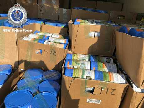 The hundreds of tins police seized in the Carlingford raid.