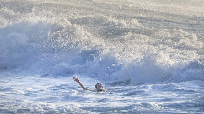 A woman screams for help as she is caught in a rip at Bronte Beach in Sydney, Australia. Picture: Jenny Evans/Getty