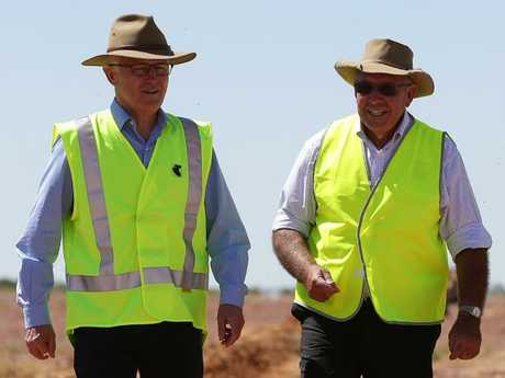Former Australian Prime Minister Malcolm Turnbull visiting a Telstra site near Birdsville with Diamantina mayor Geoff Morton. Picture: Peter Wallis