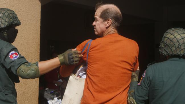Australian filmmaker James Ricketson, center, arrives at Phnom Penh Municipal Court in Phnom Penh, Cambodia, Wednesday, Aug. 29, 2018. Picture: AP.