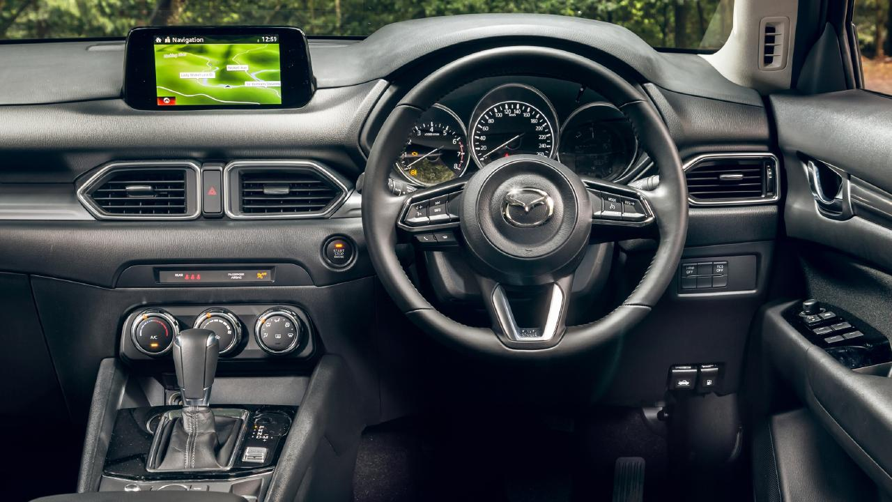 The Mazda CX-5 interior has good quality materials but the design is looking a little dated. There's no digital speedo and it has the smallest infotainment screen among this trio. Picture: Thomas Wielecki.