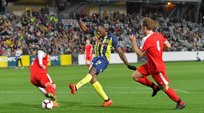 Usain Bolt gets amongst it in the Central Coast Mariners' trial game at Gosford on Friday night.