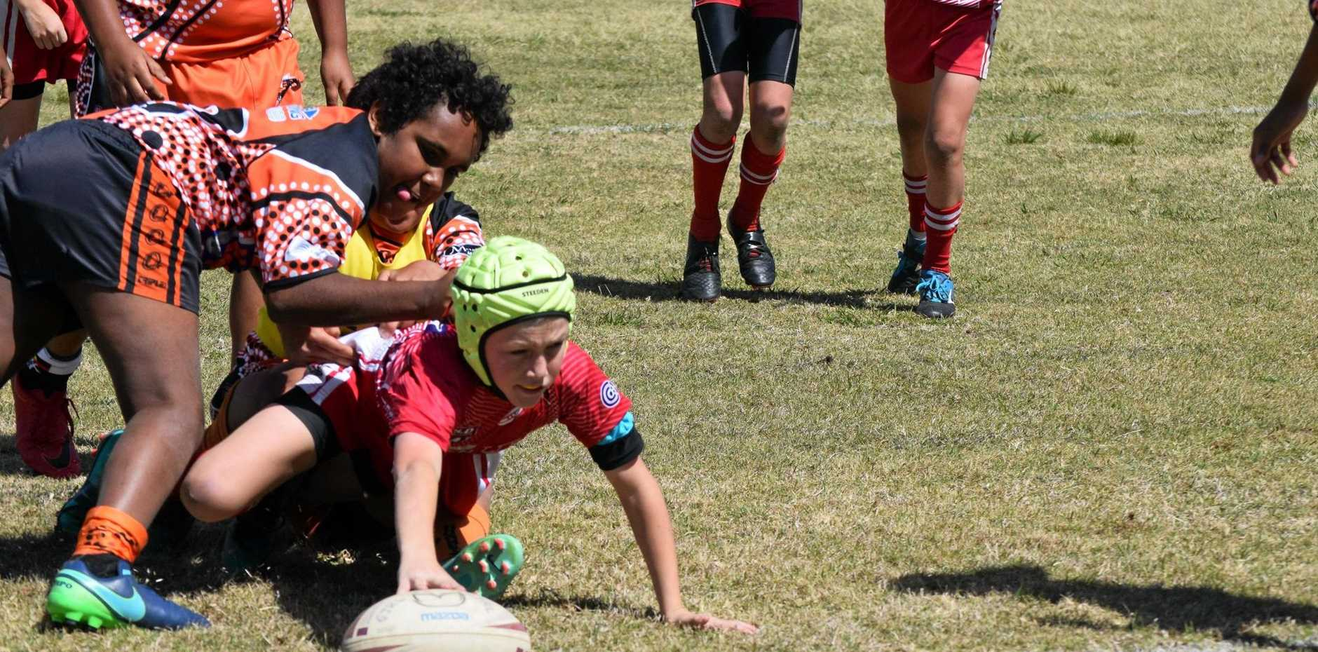 FOOTBALL FINALS: Photos from the preliminary final played between Cherbourg and Kingaroy in the under 12's division.