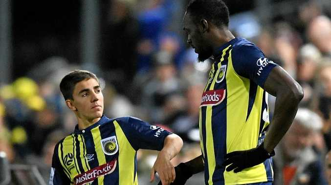 Josh Nisbet and Usain Bolt of the Mariners prepare to take to the field during a Hyundai A-League trial match between the Central Coast Mariners and the Central Coast Select XI at Central Coast Stadium in Gosford, Friday, August 31, 2018. (AAP Image/Dan Himbrechts) NO ARCHIVING, EDITORIAL USE ONLY