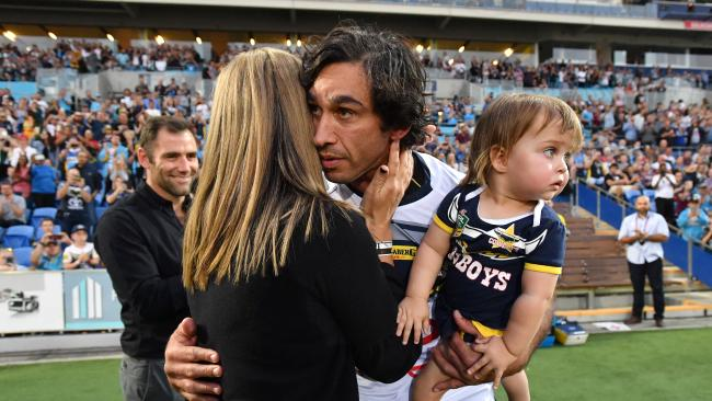 Johnathan Thurston of the Cowboys is seen hugging his wife Samantha as he runs onto the field before playing his final NRL game during the Round 25 NRL match between the Gold Coast Titans and the North Queensland Cowboys at Cbus Super Stadium on the Gold Coast, Saturday, September 1, 2018. (AAP Image/Darren England) NO ARCHIVING, EDITORIAL USE ONLY