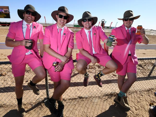 Racegoers in matching pink suits entered the novelty Fashions on the Field. Picture: AAP Image/Dan Peled.
