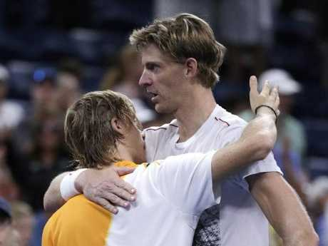 Kevin Anderson, right, hugs Canada's Denis Shapovalov after a gruelling win. Picture: AP