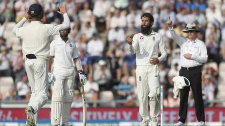 Moeen Ali claims a wicket during the recent England-India Test series. Picture: Alastair Grant/AP