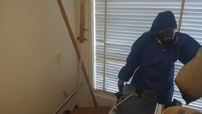 Natassia Jones on the job assisting with on-site forensic cleaning. Picture: Australian Forensic Cleaners