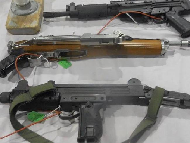 The guns range from pistols to rifles to Uzis.